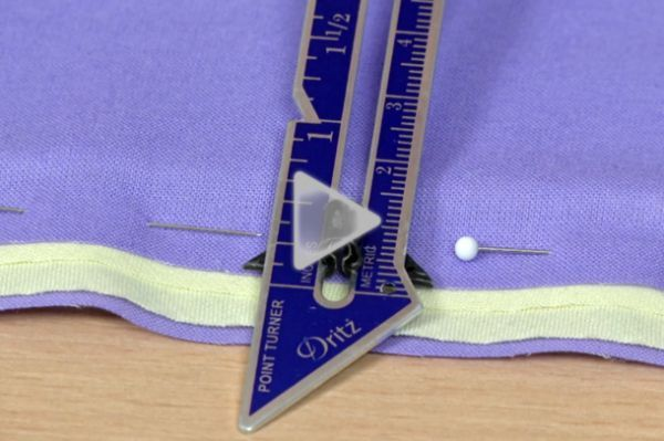 In this video, we demonstrate how to reduce seam allowance bulk in piped seams. This easy-to-follow grading technique will help create smooth piping details.