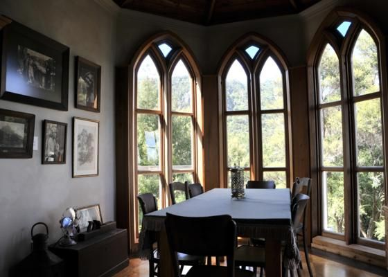 then dine in the 'cathedral room' - McLeod Bay bach or holiday home