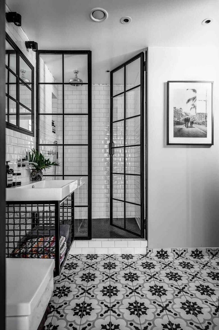 If you are looking for a chic new look to your bathroom, consider a black and white palette that feels fresh and luxurious and goes beyond just using tile.