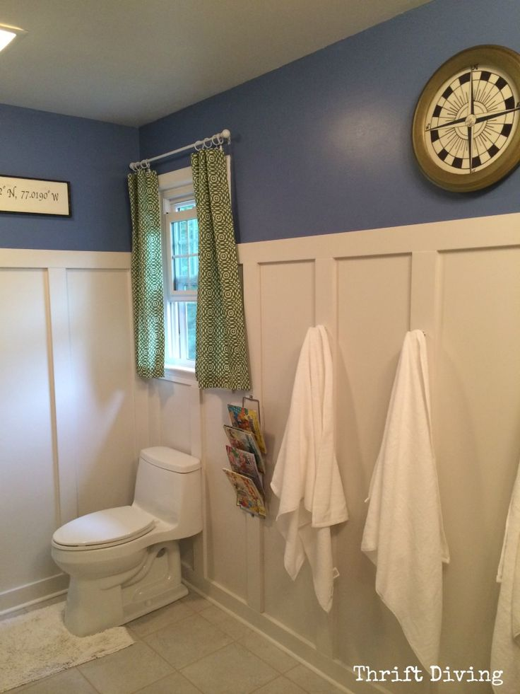 My sons' bathroom was HORRIBLE! We moved in nearly 4 years ago and it was covered in wallpaper, old vinyl floor tiles, etc. Here's how I totally transformed it in just over 30 days, all by myself!! :) Including installing the board and batten and new toilet! - Thrift Diving Blog