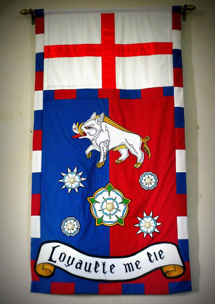 Richard III banner in St James, Sutton Cheney, where Richard III is reputed to have taken his last mass before the Battle of Bosworth.  Richard III was the founder of the College of Arms in 1484 and his personal coat of arms was of great significance to himself.  Blue, or azure meant truth and loyalty // Maroon, sanguine or murray meant patience in battle yet victorious // The boar meant bravery, fights to the death // White or silver meant peace and sincerity