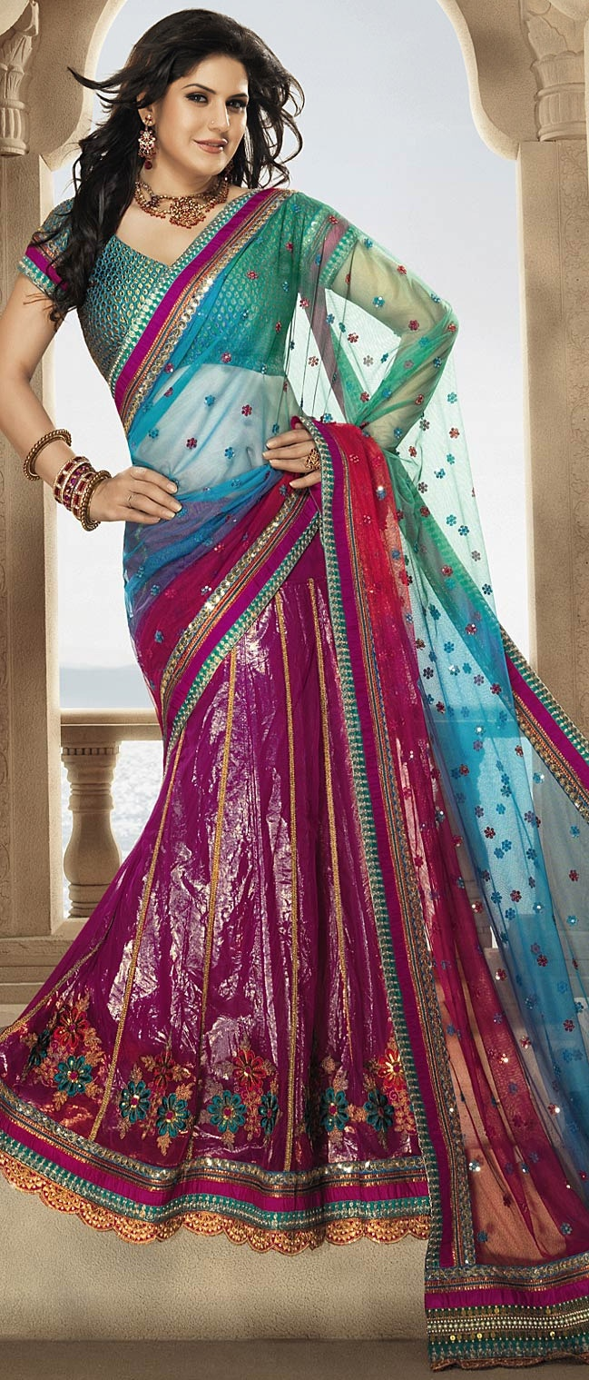 Click 'Like' if you think Zarine Khan looks sensational in #Blue & Dark #Pink Net #Saree. Indulge now : http://www.utsavfashion.com/store/sarees-large.aspx?icode=ssl1774