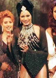 Diana Hayden in something a black swimsuit. Diana won the miss world 1997 crown at just 24 years old.    Lingerie Police says: this black heavily embellished swimsuit is definitely over the top ensemble.. though a prestigious pageant..this is a complete no no and that turban adds to its misery!