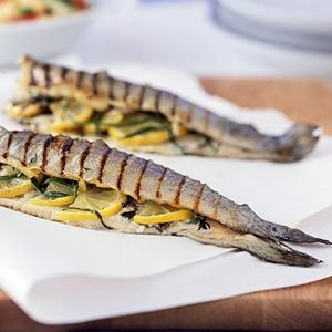 Grilled Trout Stuffed with Lemon and Herbs This is a simple, flavorful way to grill almost any whole fish, with a 'stuffing' designed not to be eaten, but to flavor the fish from the inside out.