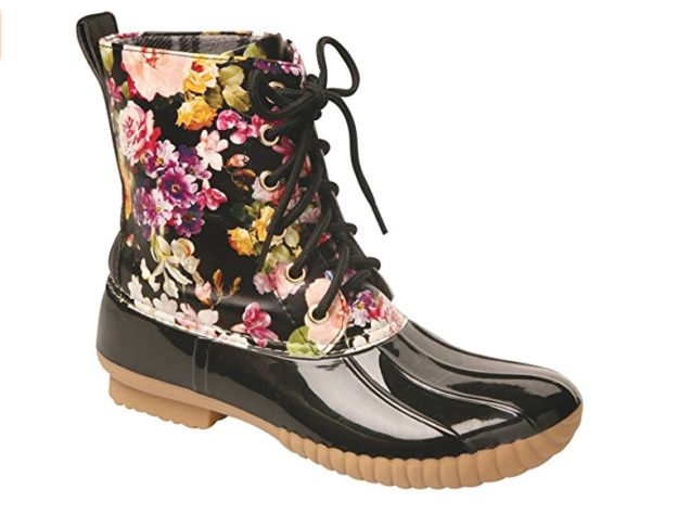 These flower-strewn duck boots. | 15 Cute Pieces Of Rain Gear To Make Your Gray Days Brighter
