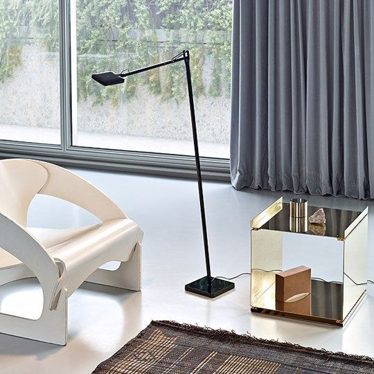 Kelvin LED F adds a contemporary element to this simple, spacious living room interior.