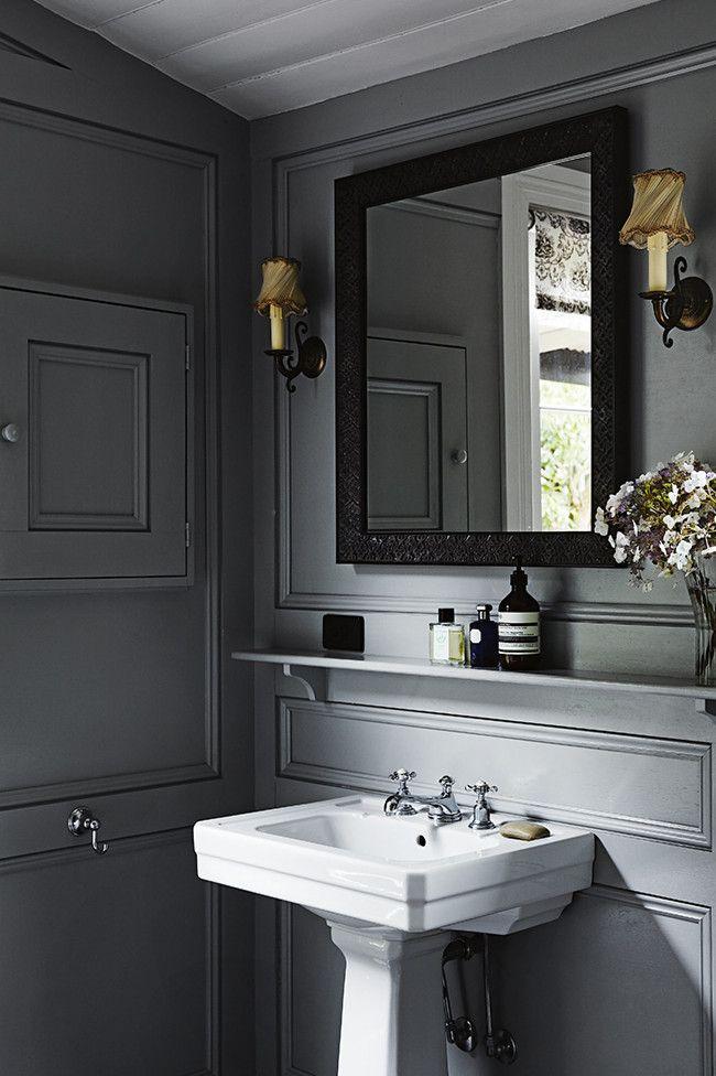 Love the dark paneled wall in this handsome bathroom for Dark gray bathroom