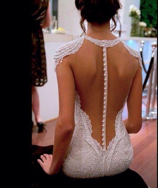 We love this sexy backless gown!  | Bride Wedding Dress Gown Iowa Ceremony Attire Groom Happily Ever Iowa | www.happilyeveriowa.com