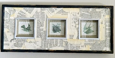 I have a bunch of old encyclopedias that I got at a resale shop so I just ripped some pages up & used mod podge to attach them. I then painted the frame black & distressed it.