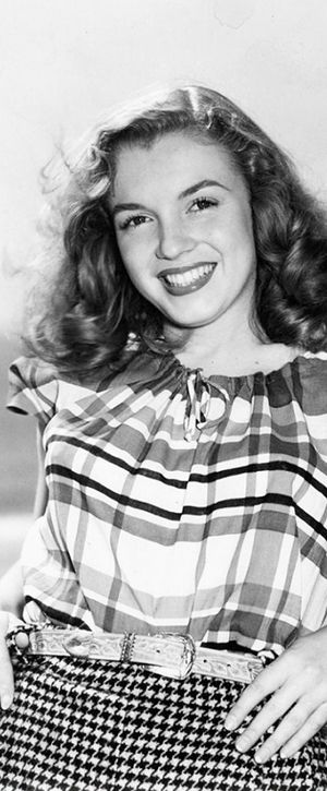 A young dark haired Marilyn Monroe.