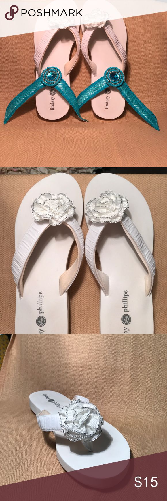 White Lindsay Phillips switch Flops The Flip Flops are from Lindsay Phillips and come with 2 sets of switchable straps. They have only been worn a few times but are in good condition and comfortable. Lindsay Phillips Shoes Sandals