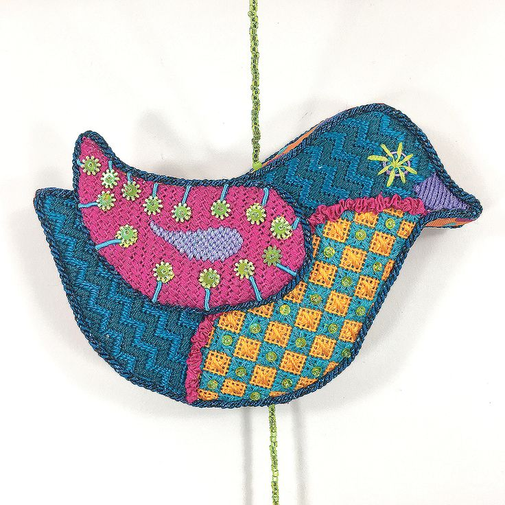 teal bird with various stitches and beads - it's not your grandmother's needlepoint