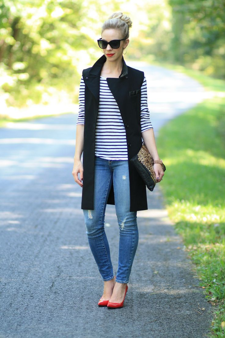 long black vest, striped black and white tee, distressed ankle jeans, leopard clutch, red patent heels