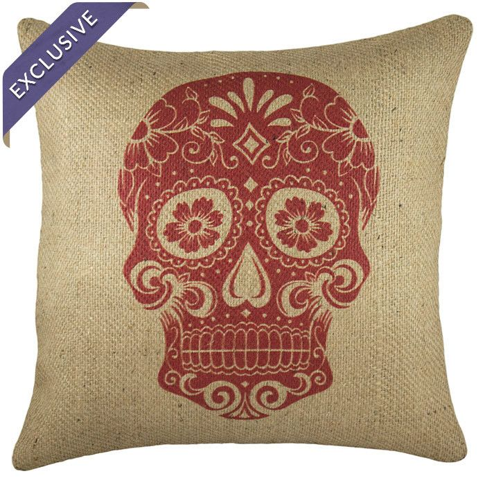 Calavera or sugar shull mask on a pillow in red. Celebrate el Dia de los Muertos!