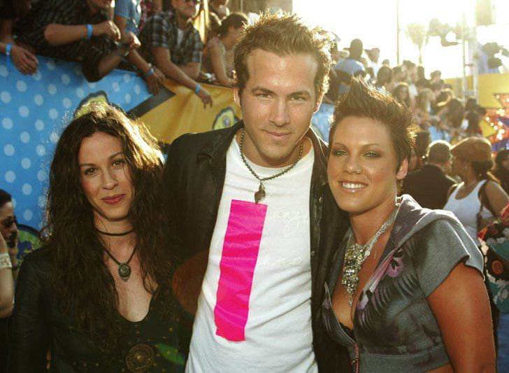 Pin for Later: Before Blake: 22 Ryan Reynolds Moments You May Have Forgotten When He Grabbed Pink For a Photo Op