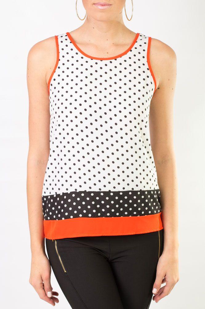 Blusa de lunares sin mangas, que combina los colores blanco, negro y ladrillo para que luzcas fabulosa.