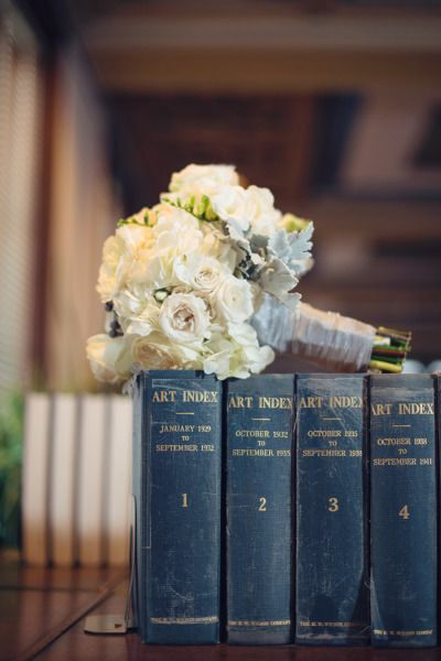 Books and bouquet: http://www.stylemepretty.com/maryland-weddings/baltimore/2015/05/27/black-tie-baltimore-library-wedding/   Photography: Audra Wrisley - http://audrawrisley.com/