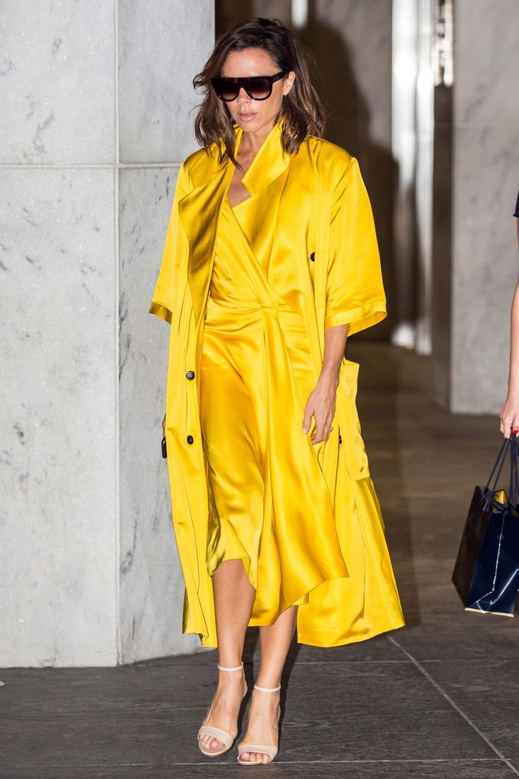 23 June Victoria Beckham made a statement in a bright yellow ensemble from her own collection as she ran errands in New York.   - HarpersBAZAAR.co.uk