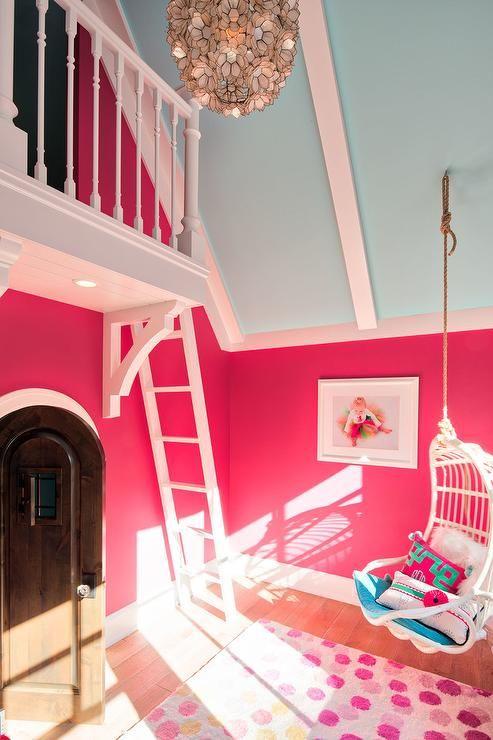 stylish pink and blue girl's bedroom is illuminateda