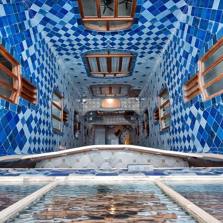 A look into Casa Batllo ~ Gaudi. Interior courtyard, providing air flow and natural air conditioning.