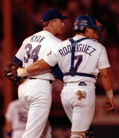 Pudge Rodriguez and Nolan Ryan