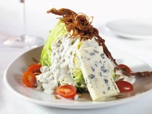 Fleming's Wedge Salad -by Sweet Leisure.  ( I just had this at Flemings Steakhouse in San Diego CA.  It was delicious.  Glad to find a recipe for it.  The bacon had a slightly sweet taste to it.  Only thing I would chg to the recipe would be to  brush bacon w/ brown sugar, maple syrup.