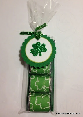 St. Patrick's Day Nugget Treats Today I'm going to show you how to make this quick and easy nugget treat bag for St. Patrick's Day. These are a great gift for teachers, neighbors, co-workers, and friends. And, they are perfect as favors for a St. Patrick's Day party. Supplies needed: Patterned paper in a St. Patrick's Day theme (I found mine at my local Hobby Lobby store.) Green cardstock White cardstock Green ink (I used Pear ink from Close to My Heart) Green ribbon Shamro