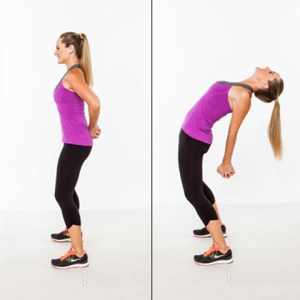 The Activity Recovery Workout: Back Extension Chest Opener | Stand with feet wider than hip width, knees slightly bent, hands clasped behind your lower back. Extend spine and arms back, bending backwards as far as you feel comfortable going, pressing your pelvis forward. Slowly return to start. Repeat up to 5 times in a row.