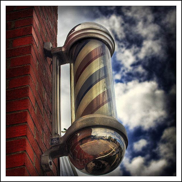 Outside 'advertisement' of an electric Barber pole at every barber shop - the red stripes went round and round - fascinating!