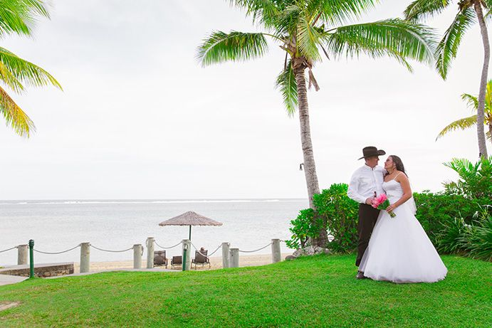Outrigger Fiji Beach Resort Wedding Ideas Planning Inspiration Tropical Paradise Style Floral Design Planning Photography Love Hat White Dress Greenery Nature Palms Outdoors Garden Seaside Ocean Sky Magical Coast Beach