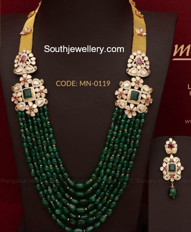 22 carat gold multistring emerald beads mala with side motifs studded with uncut diamonds, rubies and emeralds paired with matching earrings by Mangatrai Neeraj jewellers.  Emerald mala, pacchalu necklace, pusalu haram models 2018, pusalu necklace designs