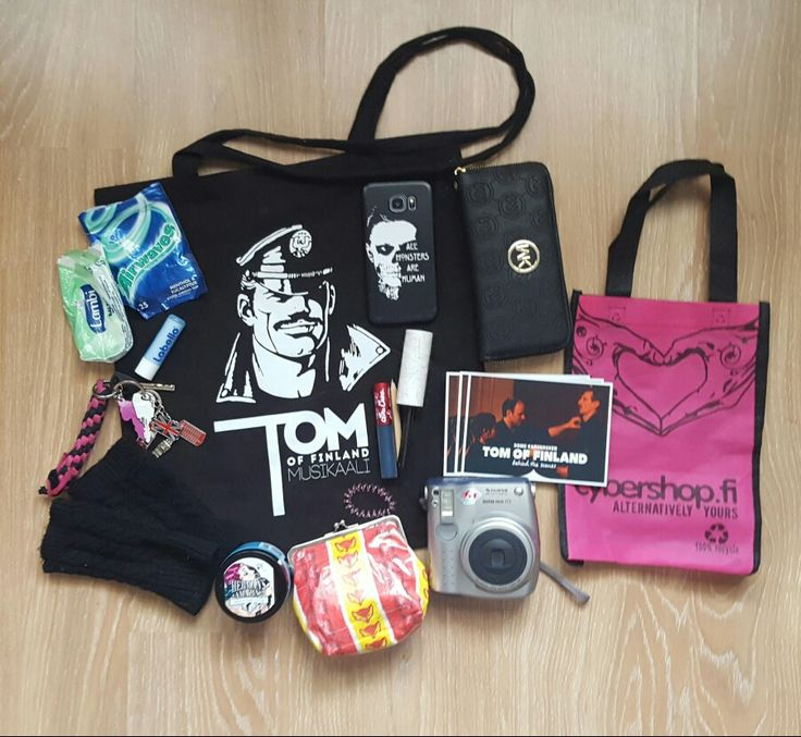 What's in my bag?  Tom of Finland-totebag incl. gum, chapstick, keys, fingerless gloves, my phone and wallet, ToF-flyers, chekicamera, pouch made of candywrappers (powerbank, a few usb sticks, more photos for the camera, earphones etc.), Herman's Amazing Haircolor (Thelma turquoise) and Cybershops bag that it came in, Lime Crimes Peacock-matte lipstick, an IKEA-pencil and a mini lintroller :D