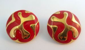 A Vintage, large,  pair of Monet red and gold retro patterned,  button earrings in raised polished gold tone metal and red enamel.