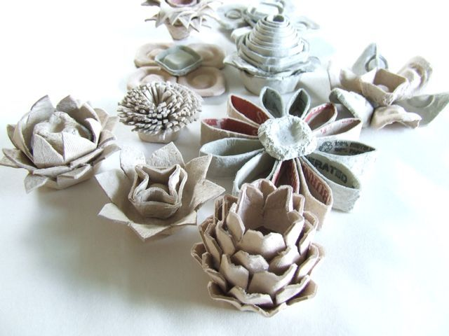 there are SO many cute crafts made out of recycable materials here, from egg carton flowers, to newspaper/gum wrapper braiding, or even denim stuff. michele made me: SERIES