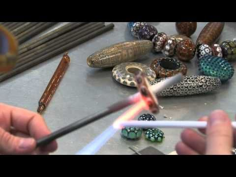 Watch as Kristina Logan demonstrates beadmaking during her Beadmaking: Expanding Your Skills class at The Studio. Logan's week-long course focuses on a broad spectrum of techniques: surface decorations, dots galore, clear casing, working large beads, and troubleshooting common mistakes and difficulties.    Kristina Logan is recognized internatio...