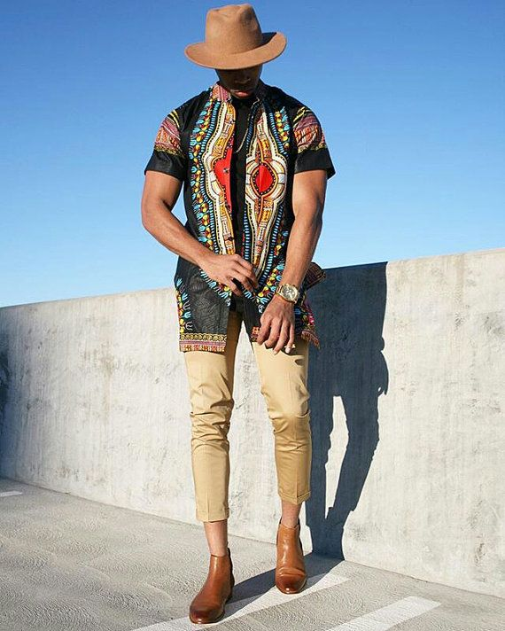 Mens tailored Dashiki shirt made with very Quality Dashiki Fabric. Made to order. All our outfits are tailored from scratch creating the flexibility