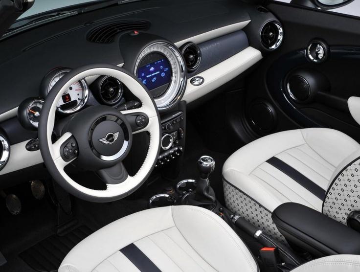 The interior of the 2 Millionth MINI, a White Silver Metallic MINI Cabrio with Denim Blue top. I need a LOVE button..lol