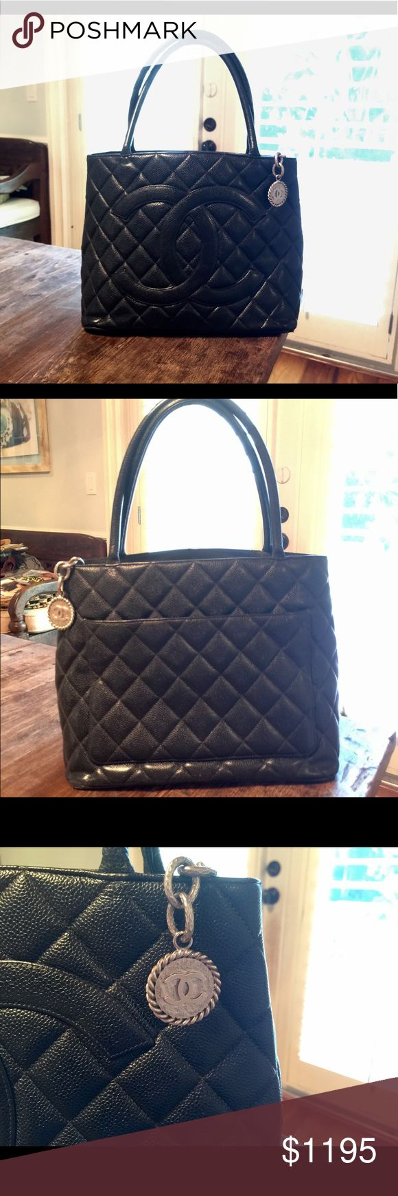 """CHANEL BLACK QUILTED CAVIAR LEATHER MEDALLION TOTE CHANEL ABSOLUTELY AUTHENTIC BLACK QUILTED CAVIAR LEATHER MEDALLION TOTE. INCREDIBLE CONDITION!!! Leather lining, silver tone hardware. One zipper inside and one open pocket on back. 12"""" long X 6"""" wide X 9.5"""" high, 6"""" handle drop. Perfect exterior, very slight signs of use inside. No marks. Market price $1,900. NO TRADES. REASONABLE OFFERS ONLY. CHANEL Bags Totes"""