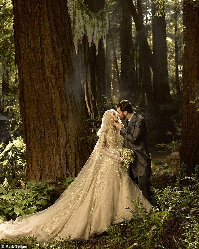 June 2013: Former Facebook president and Napster co-founder Sean Parker was fined $2.5 million after he failed to obtain permits to hold his $10 million wedding on protected lands near Big Sur, CA. He is shown here with his bride Alexander Lenas during the ceremony.