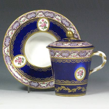 Stockspring Antiques- Madame de Pompadour bought three similar versions of this Sèvres Milk Cup and Saucer! A Sèvres milk cup and saucer, Gobelet à lait à la Reine with a socketed saucer, enforcé. Marks: crossed L's and ee for 1782, painter's mark X for Micaud père. The first examples of this form appear in the factory sales records in 1762, when Mme de Pompadour bought three. The Royal family and the Court were the main acuqirers of these, buying over fifty in the succeeding years.