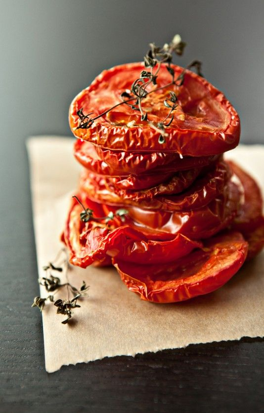 """Oven Roasted Tomatoes  8 barely ripe Romas. sliced ¼"""" thick (can be done with any tomato-roasting time will vary). lay them on a parchment lined sheet tray with a few sprigs of thyme, a light drizzle of olive oil, and a whisper of salt. Slow roast at 225* for about 4 hours or until shriveled around the edge. To store, cover with olive oil and place in the fridge."""