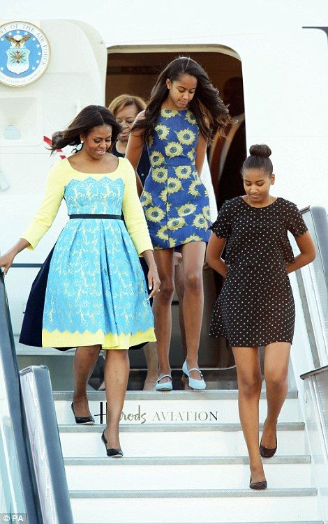 US first lady Michelle Obama (front left) accompanied by her daughters, Malia and Sasha (front right) and her mother Marian Robinson (back)