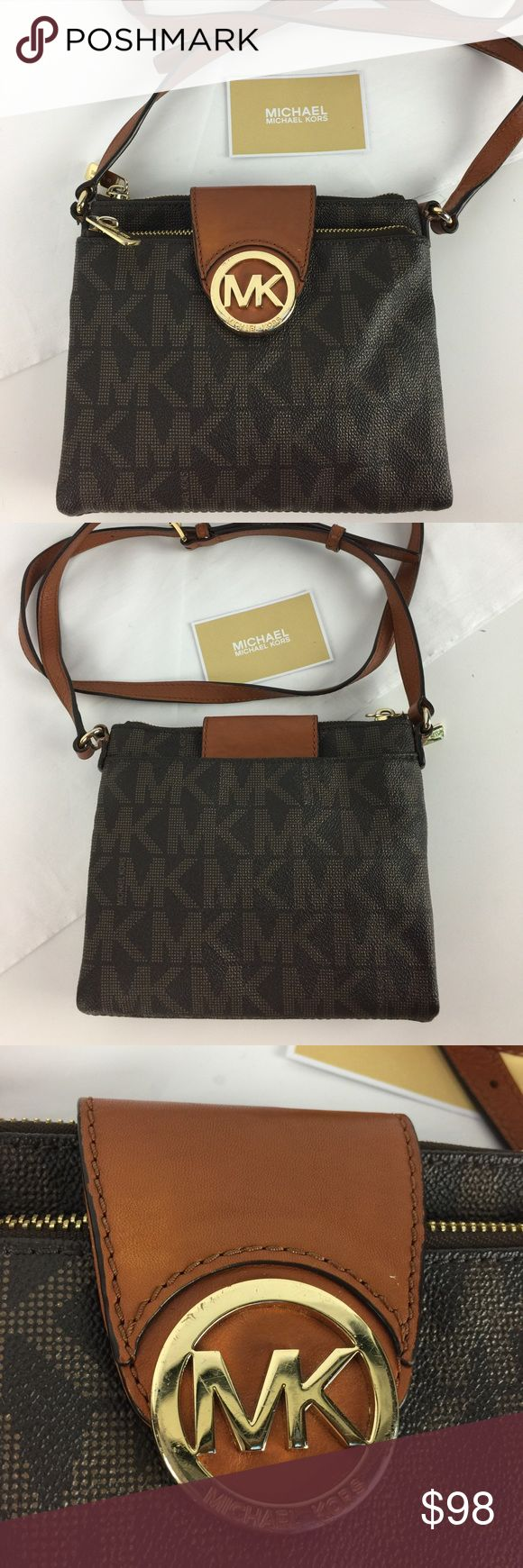 """Michael Kors Fulton Large Crossbody Bag Condition: Gently Used. Some signs of wear on hardware. Otherwise very good    This Michael Kors Fulton Crossbody features a top zip and magnetic snap closure, adjustable shoulder strap, an all over MK logo print, gold-tone hardware and logo plaque, interior zip and two slip pockets, six credit card slots and an ID holder. Measures 7.5"""" L x 1"""" D x 7"""" H.   Thank you for your interest! No Trades please. Michael Kors Bags Crossbody Bags"""