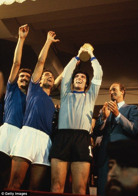 Dino Zoff holds aloft the World Cup in 1982 as King Carlos applauds