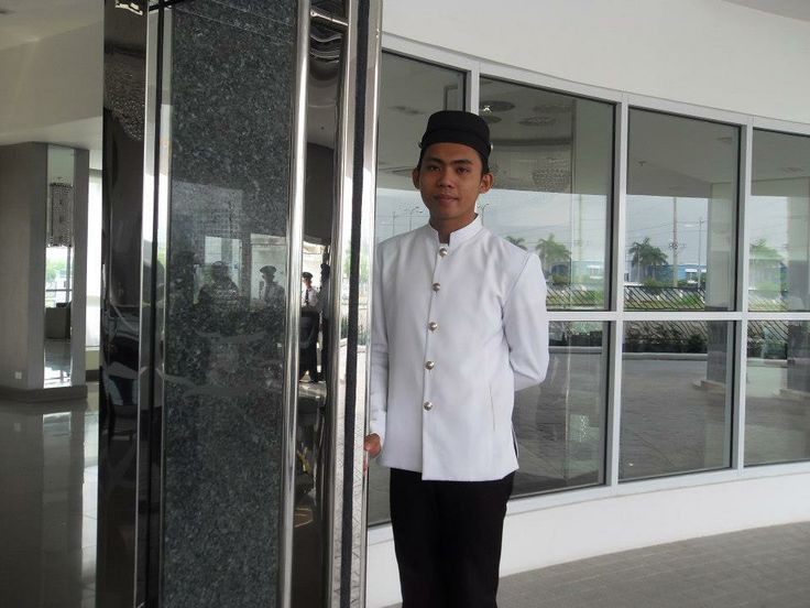 Friendly doorman greets our guests