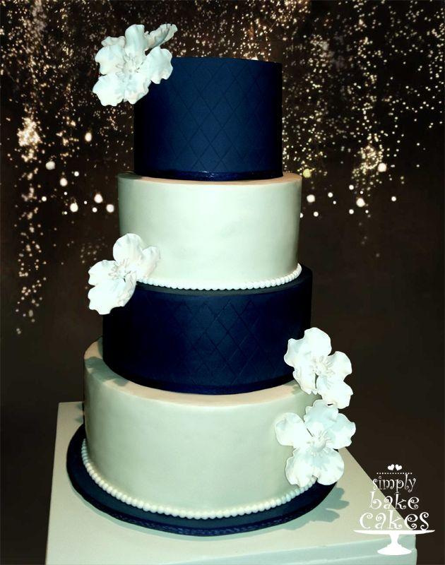 White and navy blue wedding cake, diamond pattern, white fantasy gum paste flowers: