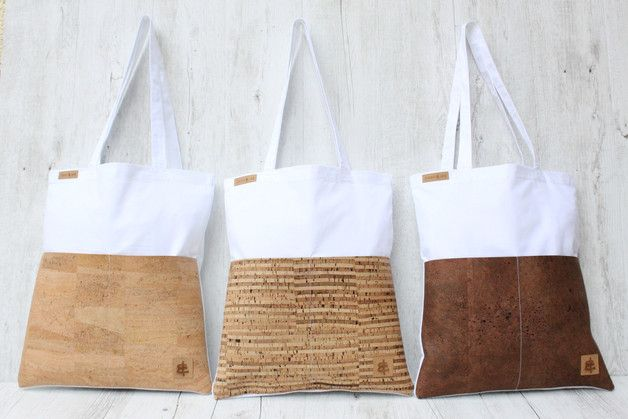 **Tote bag made of cotton in WHITE & 2 bags made of CORK in sand.** The two cork-bags on the front provide storage space for various little things. _**Cork material** - the trend material....