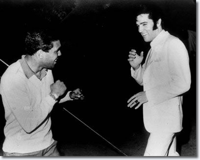 "HOLLYWOOD, 1969  |  LIONEL ROSE, 20-year-old Aboriginal boxer, and ELVIS PRESLEY meet on the set of ""The Trouble With Girls"" ,1969.  Elvis, a ready scrapper since his early days on the road, had picked up a strong interest in karate during his stint in the army.  A certified black belt, he did his own fight sequences in his movies.  There was a little light sparring - strictly for the camera -  They parted as friends, the young boxer 'pleased as punch' by the encounter."