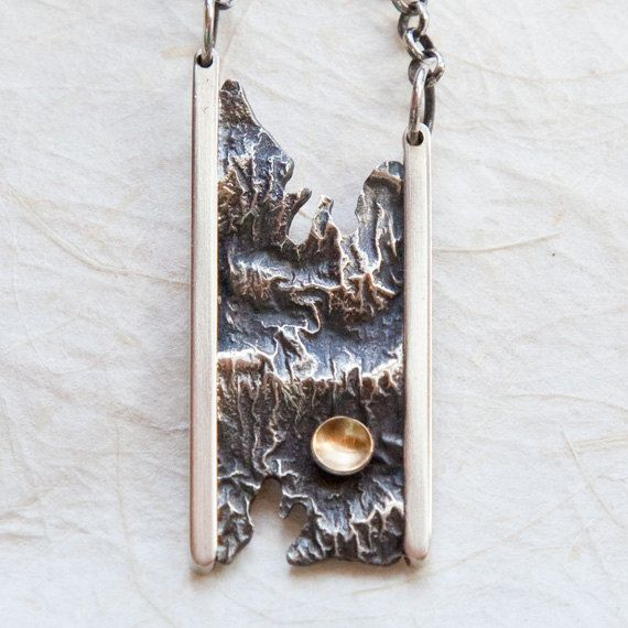 Reticulated silver pendant with 22K gold accent  TexturedMetalDesigns, $135.00