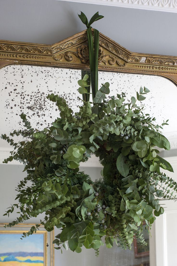 Eucalyptus wreath using various different varieties to make it rich in scent and highly decorative. I love hanging wreaths on all of my mirrors. I have a big mirror in the hall that gets either festive garlands of a wreath like this one. Created and hand tied by BUTTER WAKEFIELD